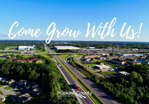 grow with us text overlaying aerial view of hopkins area